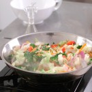 Cooking stir fried vegetables in wok