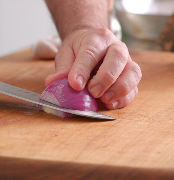 Cutting a red/Spanish onion