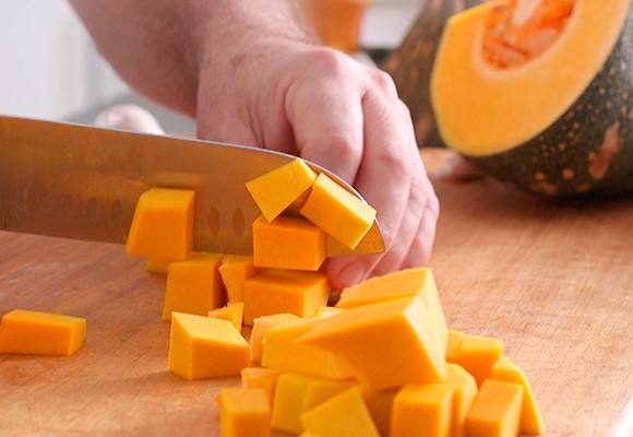 Cutting pumpkin into cubes