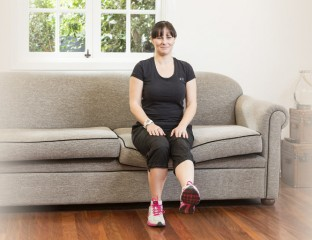 Woman doing leg raises on couch